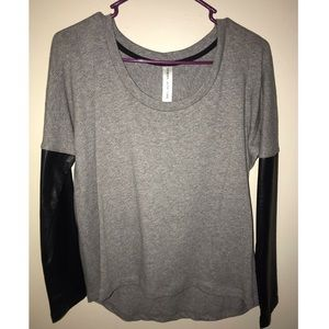 Long sleeve gray shirt. Never worn.